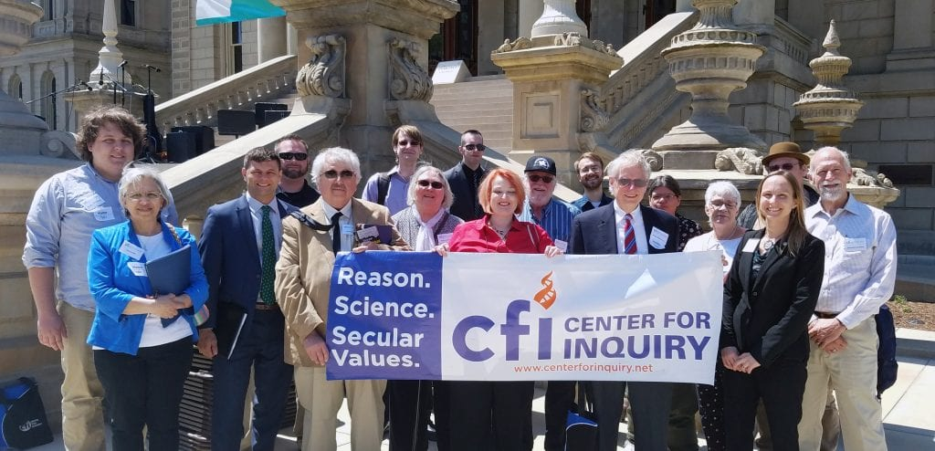 Jennifer Beahan, CFI MI Executive Director, and Jason Lemieux, CFI Public Policy Director with CFI Members outside the Michigan Capitol building in Lansing at the 2018 Advocacy Day!